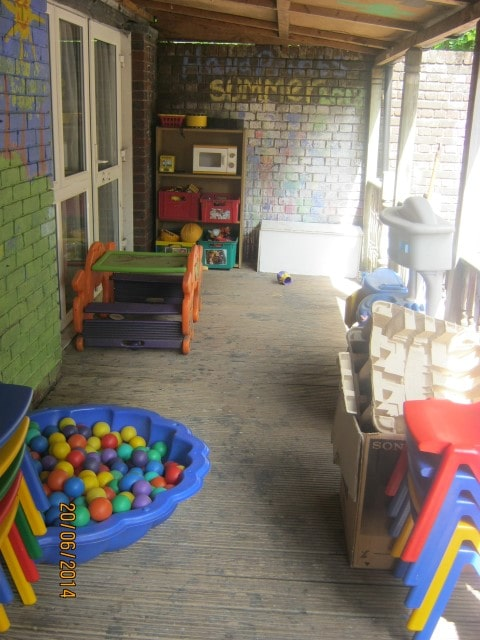 Our delightful covered, boarded outside play area
